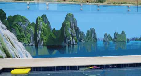 Image of pool side mural showing HaLong Bay Vietnam